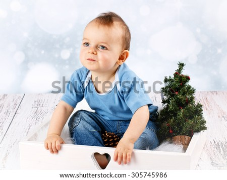 Adorable  little baby boy with christmas tree - stock photo
