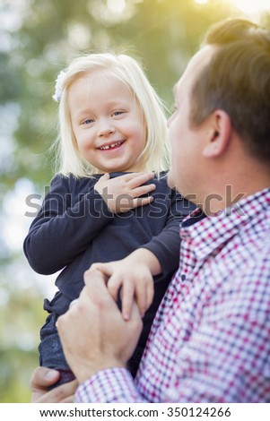 Adorable Little Baby Girl Having Fun With Daddy Outdoors. - stock photo