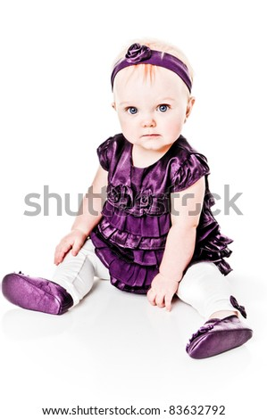 Adorable little baby girl with big blue eyes - stock photo