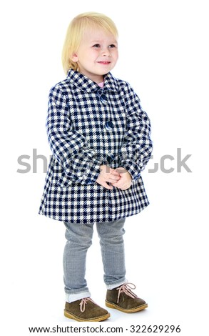 Adorable little blond girl in autumn coat in the box is turned sideways to the camera-Isolated on white background - stock photo
