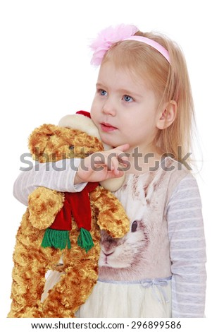 Adorable little blonde girl hugs his favorite soft toy, close-up-Isolated on white - stock photo