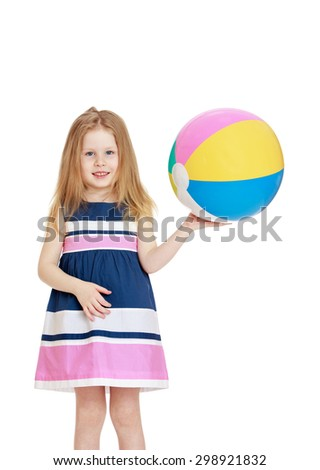 Adorable little blonde girl with her hair in a linen striped dress holding a striped beach ball, girl vacationing with his parents at sea , close-up-Isolated on white background - stock photo