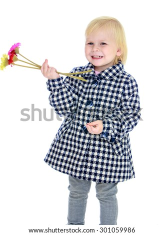 Adorable little blonde girl with short hair in a checkered coat fall. The girl holds a hand a small bunch of flowers and smiling. close-up-Isolated on white background - stock photo