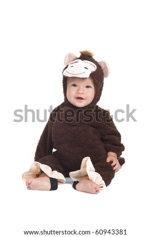 Adorable little boy dressed as a monkey in the studio - stock photo