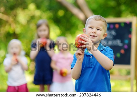 Adorable little boy feeling extremely excited about going back to school - stock photo
