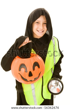 Adorable little boy in his Halloween costume, with a reflective vest and flashlight.