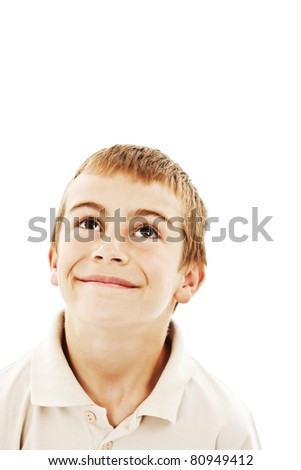 Adorable little boy looking up, isolated on white background - stock photo