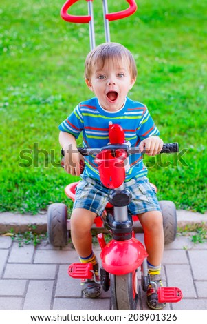 adorable little boy on a bicycle in the park