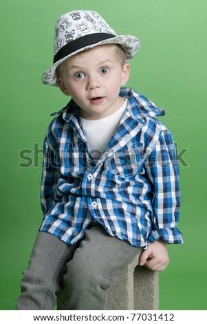Adorable little boy wearing blue plaid shirt