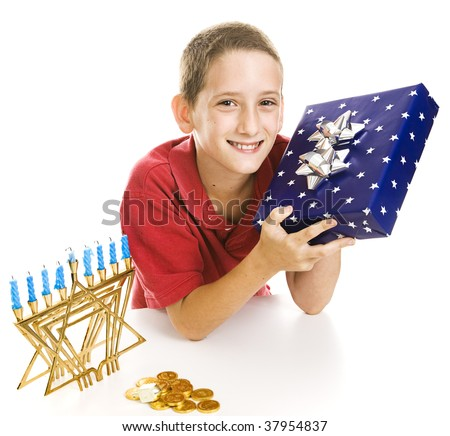 Adorable little boy with a Chanukah gift, menorah, dreidel and gelt.  Isolated on white. - stock photo