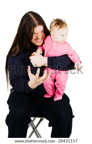 Adorable little child and fearful long hair man expressing agression - stock photo