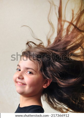 adorable little elementary girl with messy hair - stock photo
