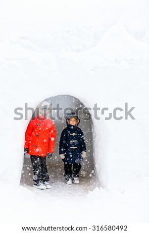 Adorable little girl and cute boy outdoors on beautiful cold winter day with snow - stock photo