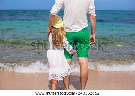 Adorable little girl and happy dad during beach vacation - stock photo