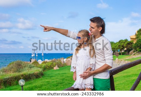 Adorable little girl and happy dad outdoor - stock photo