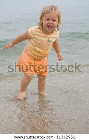 Adorable Little Girl at Beach - stock photo
