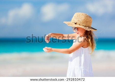 Adorable little girl at tropical beach during summer vacation - stock photo