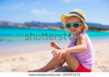 Adorable little girl at tropical beach during vacation - stock photo