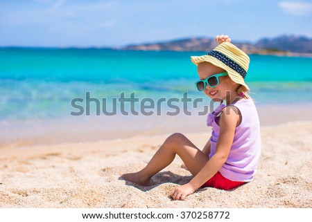 Adorable little girl at white beach during tropical vacation - stock photo