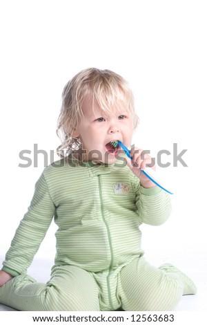 Adorable Little Girl Brushing Teeth - stock photo