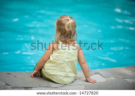 Adorable Little Girl by Pool - stock photo