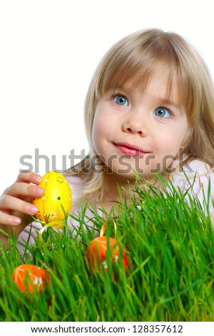 Adorable little girl collecting Easter eggs in her basket. Vertical view. Isolated white backround - stock photo
