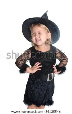 Adorable little girl dressed as witch - stock photo
