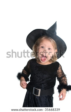 Adorable little girl dressed in witch costume - stock photo