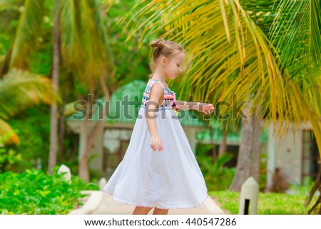 Adorable little girl during beach vacation having fun on summer vacation - stock photo