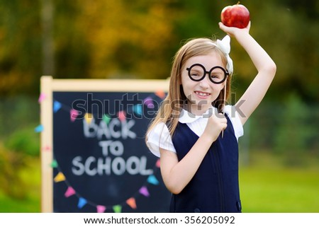 Adorable little girl feeling very exited about going back to school - stock photo