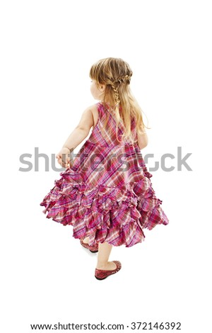 Adorable little girl goes back turned to the camera, rear view. Isolated on white background   - stock photo
