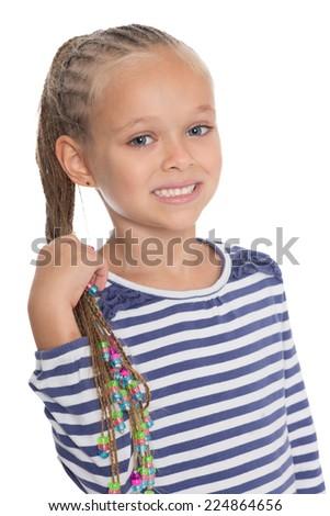 Adorable little girl holding dreadlocks. Six years. - stock photo