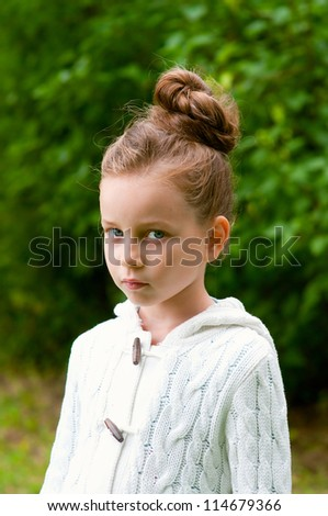 Adorable little girl in a park