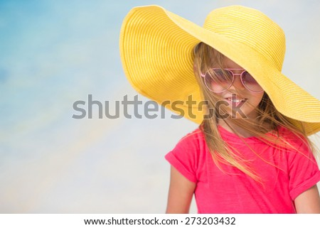 Adorable little girl in hat at beach during summer vacation - stock photo