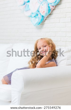 Adorable little girl in her room. - stock photo