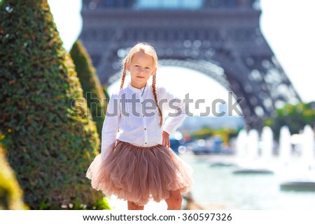 Adorable little girl in Paris background the Eiffel tower during - stock photo