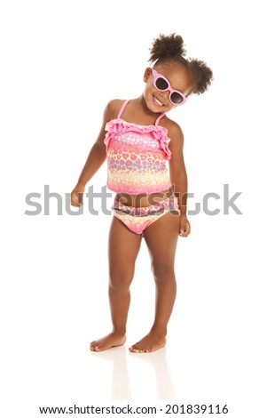 Adorable little girl in sunglasses and a bathing suit. Isolated on white. - stock photo