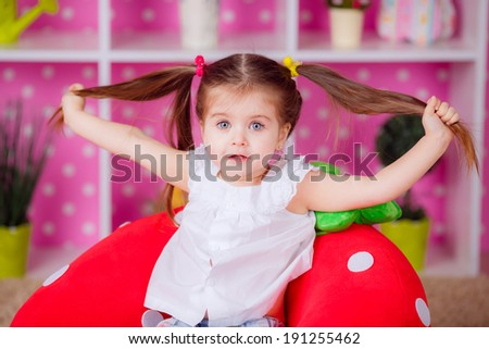 Adorable little girl in the nursery. emotions, fun, children's world - stock photo