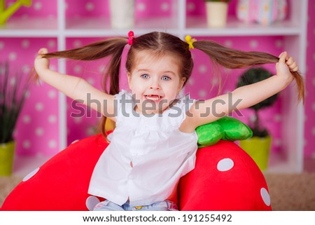 Adorable little girl in the nursery. emotions, smile, children's world - stock photo