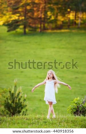 Adorable little girl in white dress - stock photo