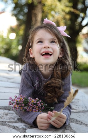 Adorable little girl laughing. Happy girl. A child without milk teeth. Toothless smile. - stock photo