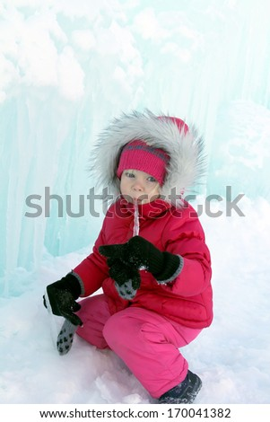 Adorable little girl licking the icicle - stock photo