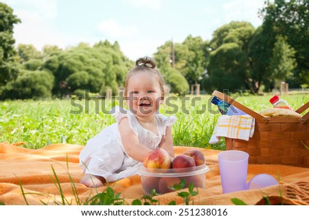 Adorable little girl on picnic in the beauty park - stock photo