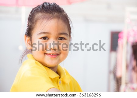 Adorable little girl on smile - stock photo
