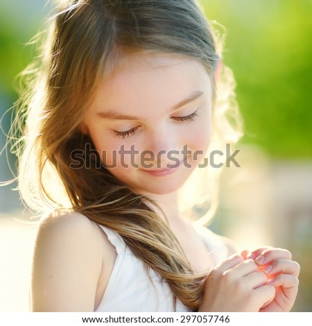 Adorable little girl on warm and sunny summer day