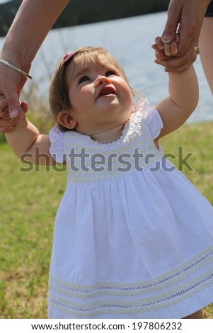 Adorable little girl outdoors in Summer - stock photo