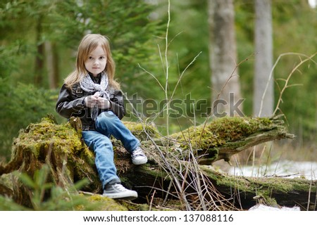 Adorable little girl portrait outdoors at spring or autumn - stock photo