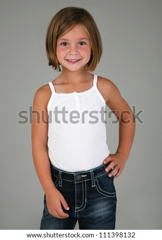 Adorable Little Girl Posing with hand on hip on Grey Background - stock photo