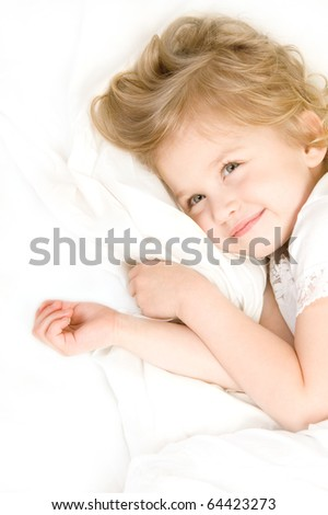 Adorable little girl resting in the bed close-up - stock photo