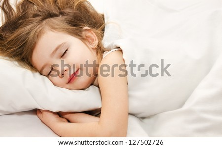 Adorable little girl sleep in the bed - stock photo
